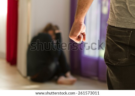 Man beating up his wife illustrating domestic violence Royalty-Free Stock Photo #261573011