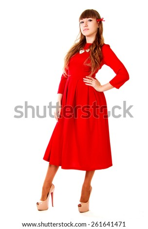 Young woman in a bright red evening dress isolated over white background #261641471