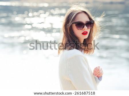 fashion girl in sunglasses. vacation at sea #261687518