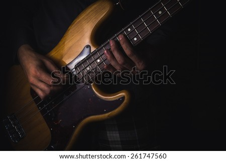 Man playing on bass guitar #261747560
