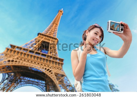 Happy travel woman in Paris with Eiffel Tower and she take a selfie picture, asian beauty