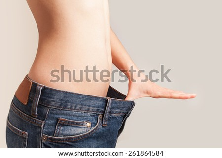 The girl lost weight and was wearing jeans large size. #261864584