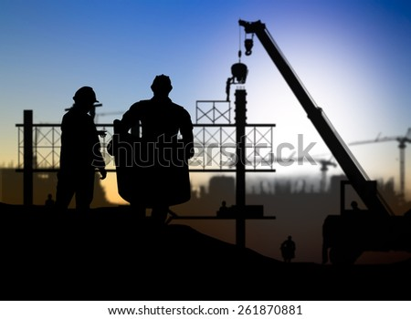 silhouette man engineer looking construction worker in a building site over Blurred construction site #261870881