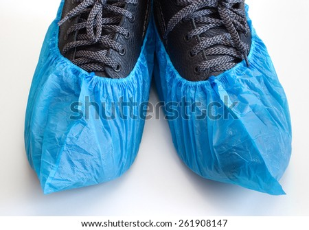 Overshoes on the boots #261908147