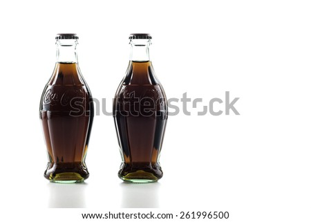 Istanbul,Turkey - March 19,2015 : Nostalgic Coca-Cola 250 ml bottles isolated in white backgrounds #261996500