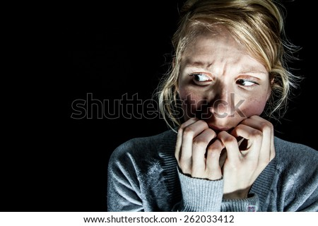 Scary Woman Afraid of something in the Dark Royalty-Free Stock Photo #262033412