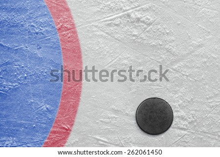 The puck lying on a hockey rink. Texture, background