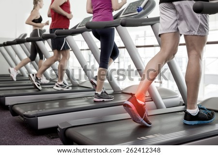 Digital composite of Highlighted ankle of man on treadmill #262412348