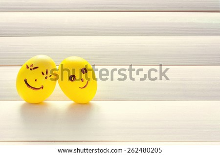 Easter eggs. Funny eggs on a light board. Easter 2015. Eggs smilies. Happy easter. Toning in a warm color.