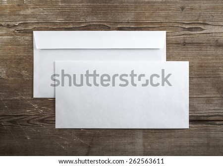 Photo of blank envelopes on a dark wooden background. Back and front. Template for branding identity. Top view. Royalty-Free Stock Photo #262563611