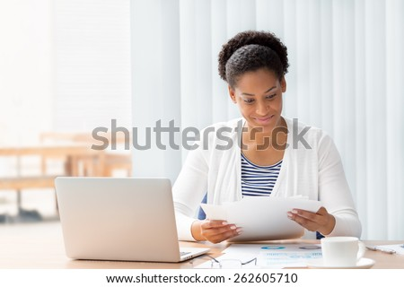 Businessowman working with papers in office #262605710
