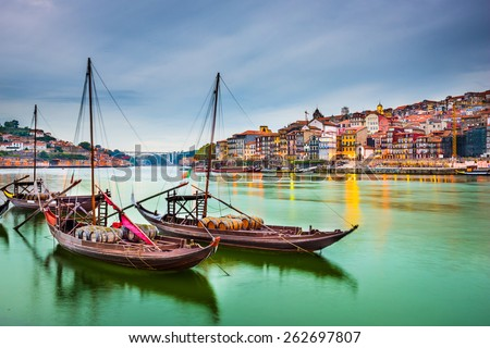 Porto, Portugal old town cityscape on the Douro River with traditional Rabelo boats. Royalty-Free Stock Photo #262697807