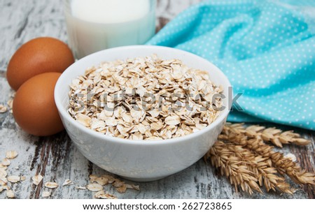 Bowl of oats on a old wooden background #262723865