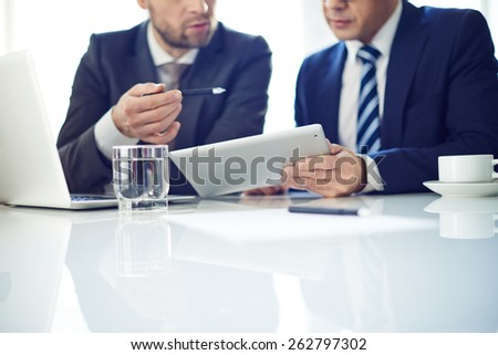 Two businessmen with tablet discussing project Royalty-Free Stock Photo #262797302
