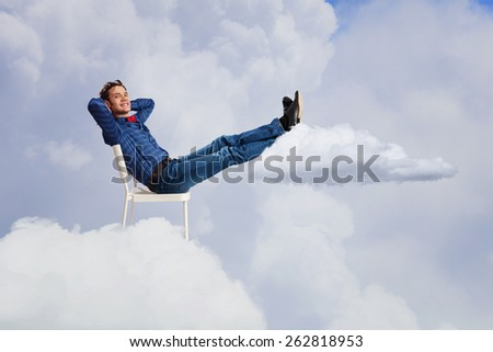 Young man sitting in chair with legs up and relaxing #262818953