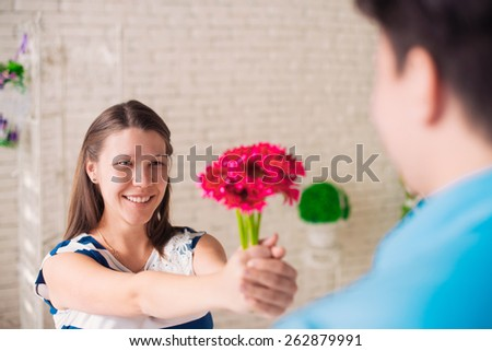Happy girl giving flowers to her husband #262879991