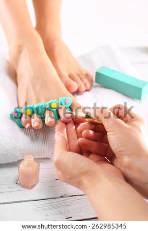 Pedicure. Foot care treatment and nail, the woman at the beautician for pedicure. #262985345