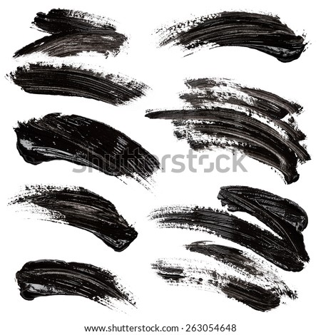 Strokes of black paint isolated on white background Royalty-Free Stock Photo #263054648