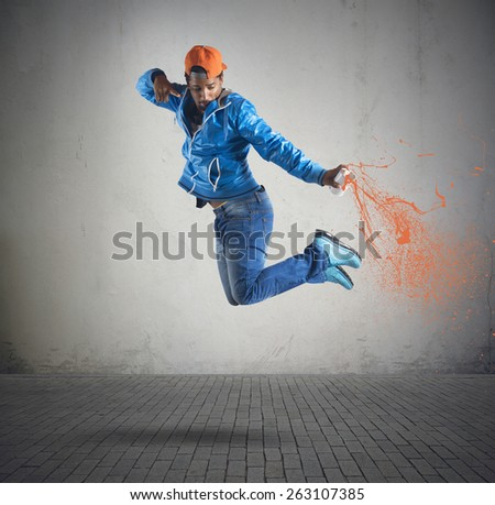 Boy jumps and color with the spray #263107385