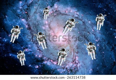 Astronauts spaceman suit galaxy spiral people space milky way. Elements of this image furnished by NASA.