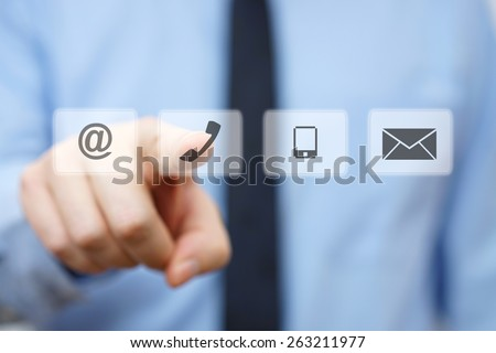 businessman pressing phone button, company identification icons Royalty-Free Stock Photo #263211977