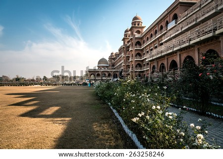 New campus of university of Peshawar, Pakistan. Build in historic architectural style. Shadow of the building casting on the ground outlines the architecture. #263258246
