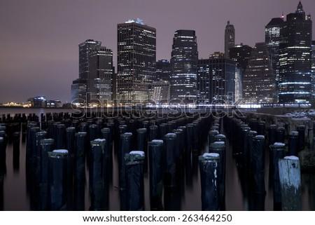 Lower Manhattan skyline night view from Brooklyn Bridge Park in New York City.  #263464250