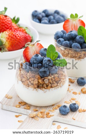 diet dessert with yogurt, muesli and fresh berries, vertical #263719019