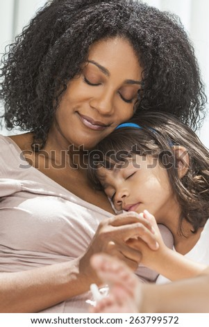 Portrait of a beautiful middle aged African American woman at home relaxing resting sleeping with her female child daughter #263799572