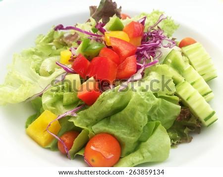 Fresh vegetable salad on white plate #263859134