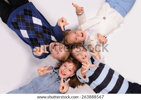 children lying on the floor isolated over white background #263888567