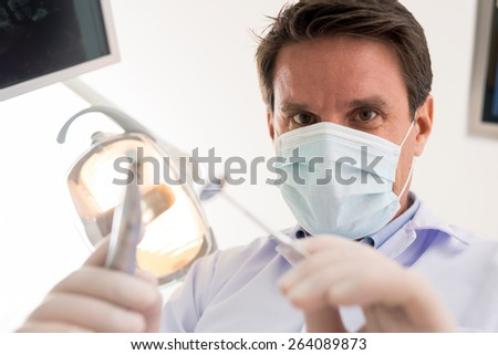Dentist treating a tooth, point of view of the patient #264089873