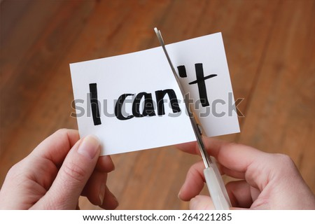 I can self motivation - cutting the letter t of the written word I can't so it says I can Royalty-Free Stock Photo #264221285