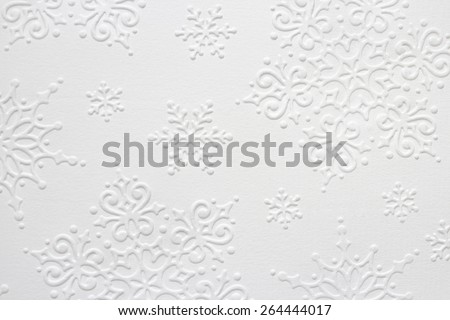 Embossed Snowflake Pattern on White Paper Structure Royalty-Free Stock Photo #264444017