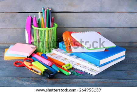 Colorful stationery on wooden background Royalty-Free Stock Photo #264955139