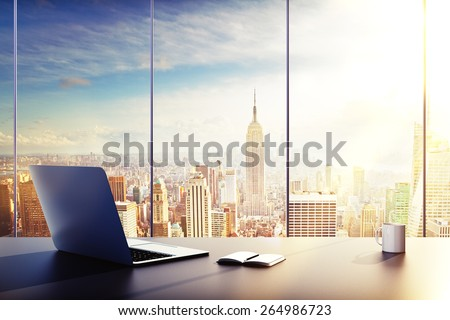 laptop, cup and diary on table in office #264986723