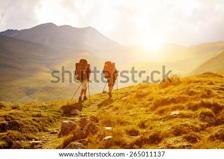 hikers on the trail in the Caucasian mountains. Trek to Kazbek mount Royalty-Free Stock Photo #265011137