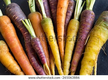 Fresh organic rainbow carrots on a wooden table #265063886