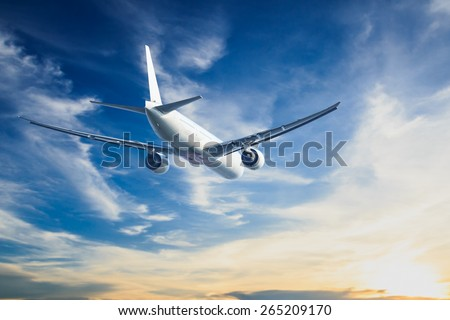 air plane flying on blue sky #265209170