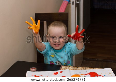 the little boy draws bright paints in an art album #265276991