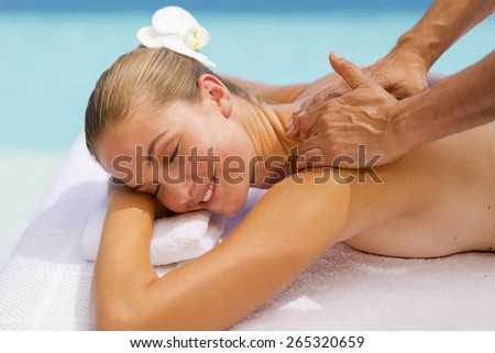 Young attractive girl receiving shoulder massage. #265320659
