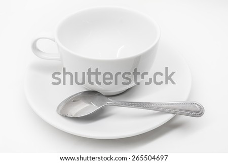 A white ceramic cup with saucer and silver teaspoon isolated on white background #265504697