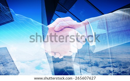 Business people shaking hands against skyscraper #265607627