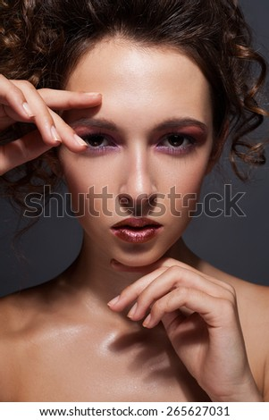 Beautiful woman framing her face with hands and smiling #265627031
