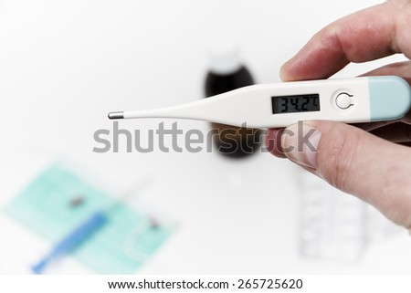 Set for flu treatment -  pills, thermometer, nasal sprays, protective surgical mask, stethoscope, syringe... #265725620