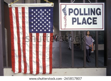 Children at the entrance to a polling place, CA #265817807