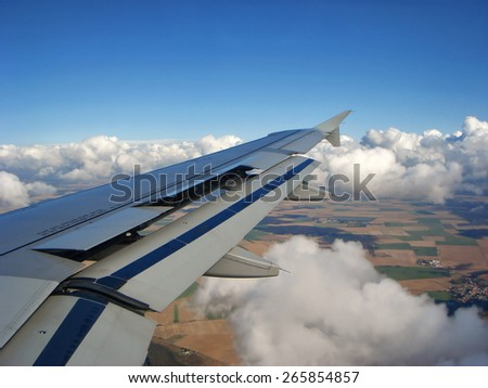 Airplane over the Clouds Royalty-Free Stock Photo #265854857