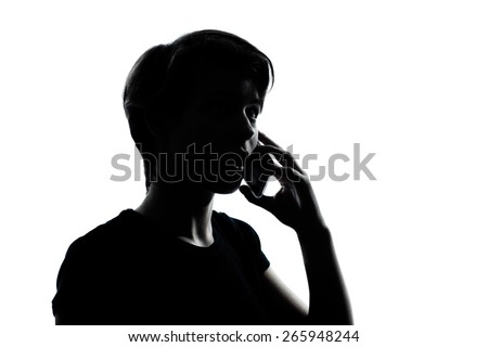 one  young teenager silhouette boy or girl on the telephone portrait in studio cut out isolated on white background #265948244