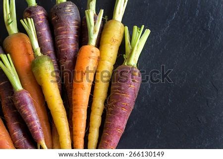 Fresh organic rainbow carrots on a dark background #266130149