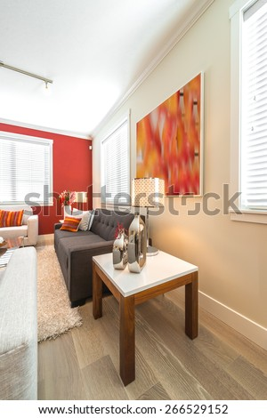 Luxury modern living suite with red color walls, room with sofa and chairs and nicely decorated with vase coffee table. Interior design of a brand new house. Vertical. #266529152